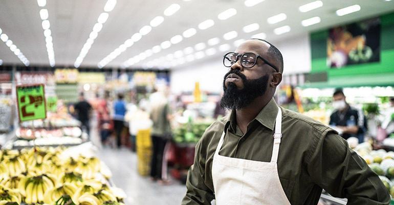 stressed supermarket employee