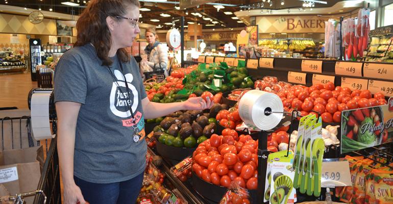 A Fast Lane personal shopper prepares an order at SpartanNash store