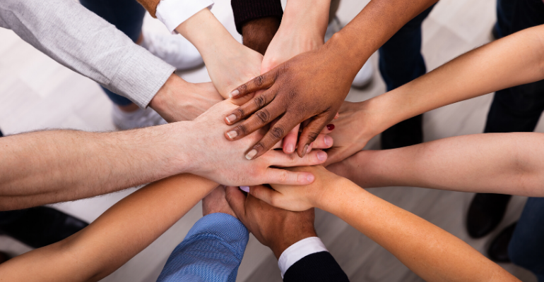 Diverse Team All Hands In