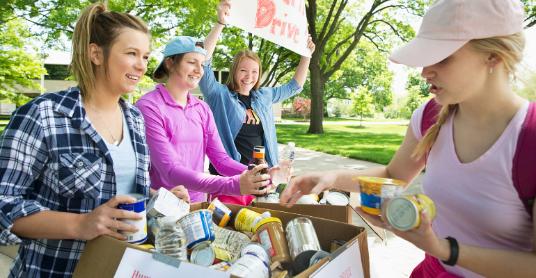 People Donating to a Food Drive