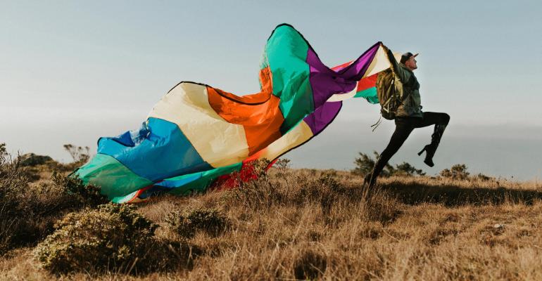 Pattie Gonia Flying a Rainbow Flag