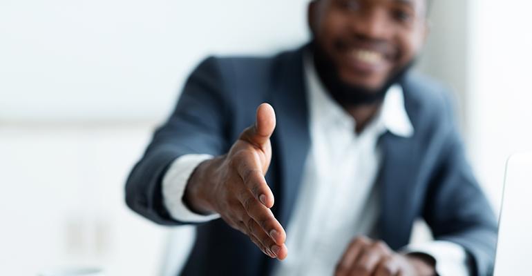 black-entrepreneur-shaking-hands.png