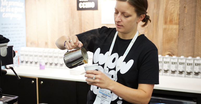 Woman at Oatly booth, Expo East 2018