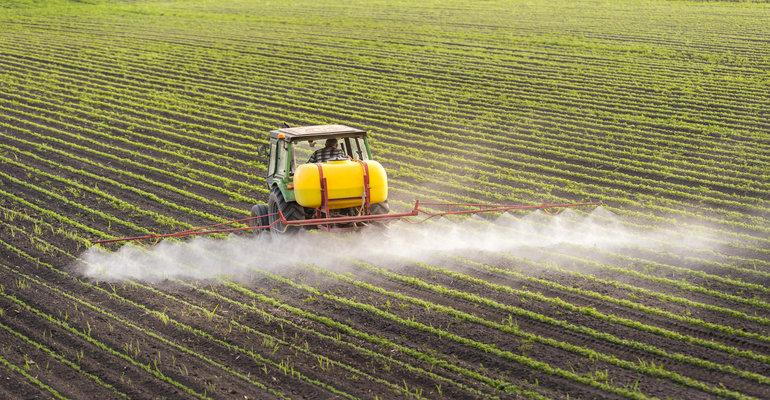 A farmer sprays his crops with weedkiller