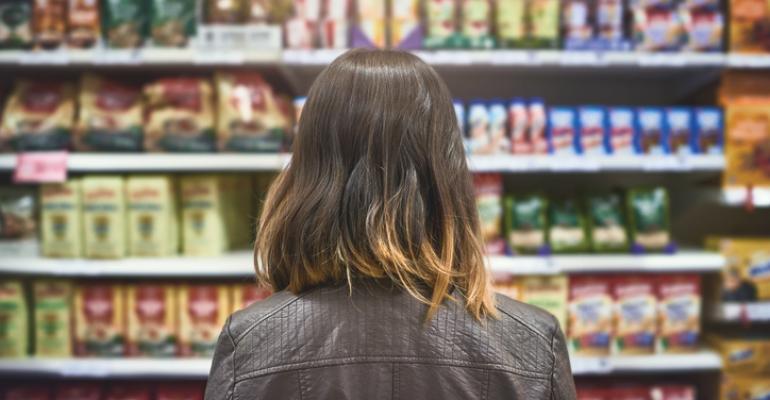 woman grocery shopping at shelf