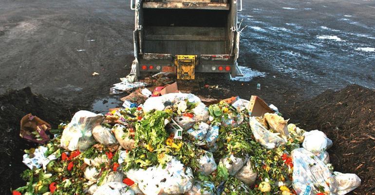 food waste behind garbage truck