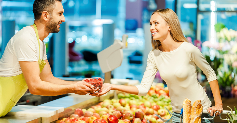 produce grocery clerk with customer