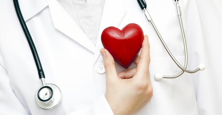 doctor holding wooden heart