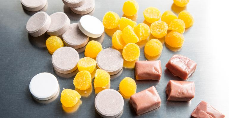 Supplements pile with gummies and tablets