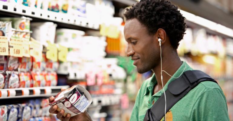 man reading food labels