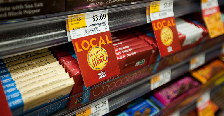Local labels on Whole Foods shelves