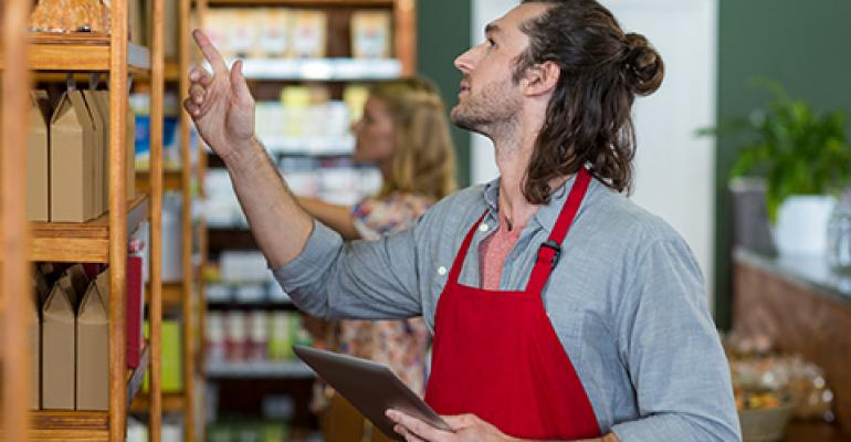 man checking health food store inventory