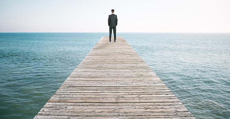 man-overlooking-ocean.jpg
