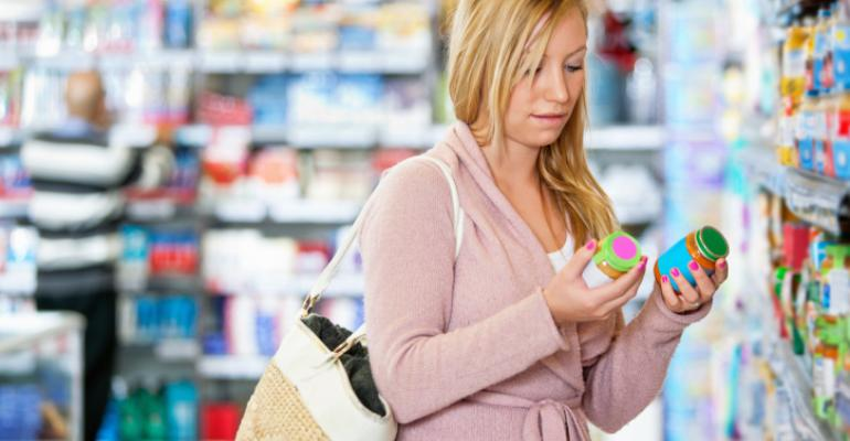 millennial food shopper checking labels