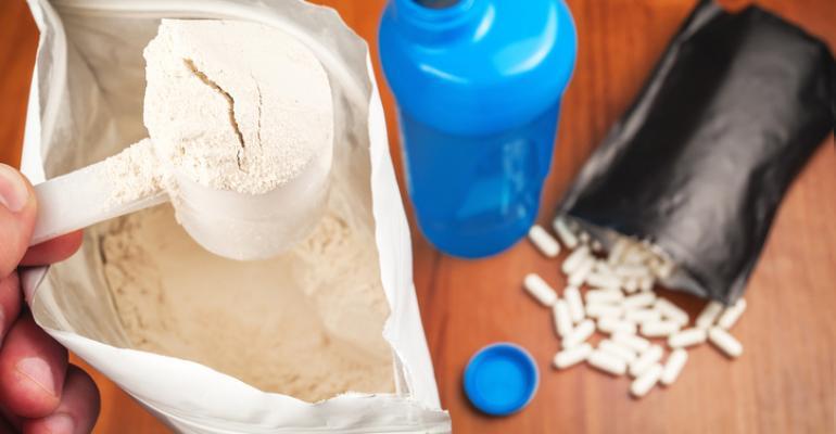 millennial making protein shake supplement