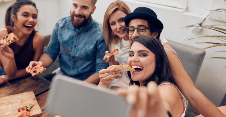 millennials eating pizza