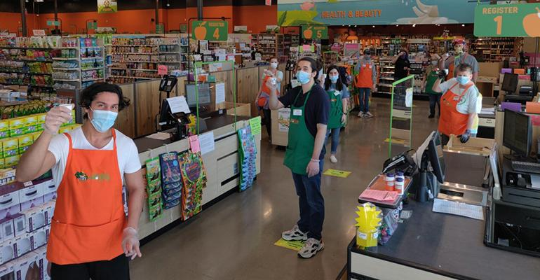Natural Grocers employees demonstrate social distancing during the COVID-19 pandemic.