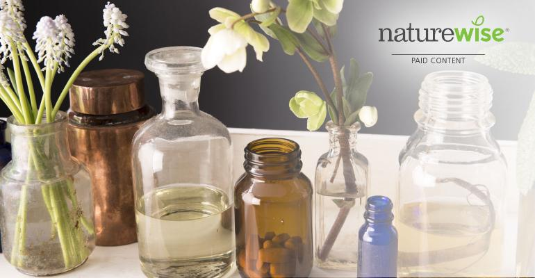 Bottles with flowers and NatureWise logo