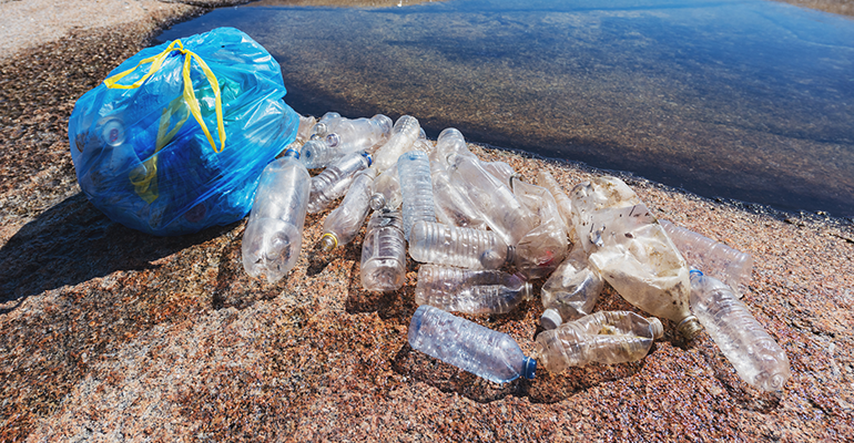 plastic bottles on beach