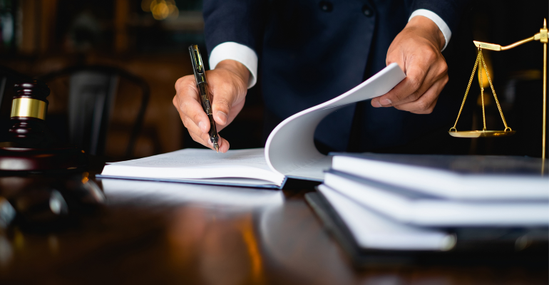 Man signing legal documents