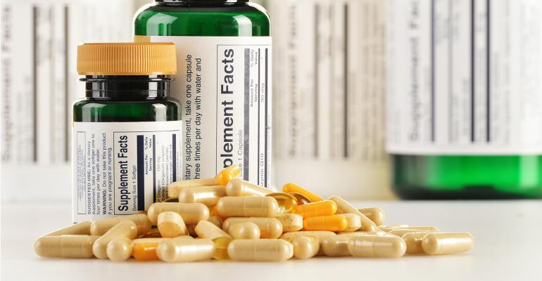 Supplements with labels on green bottles