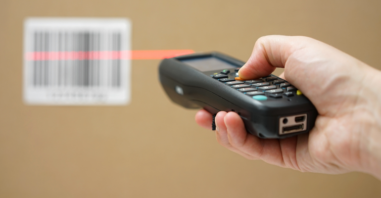Hand scanning a UPC code