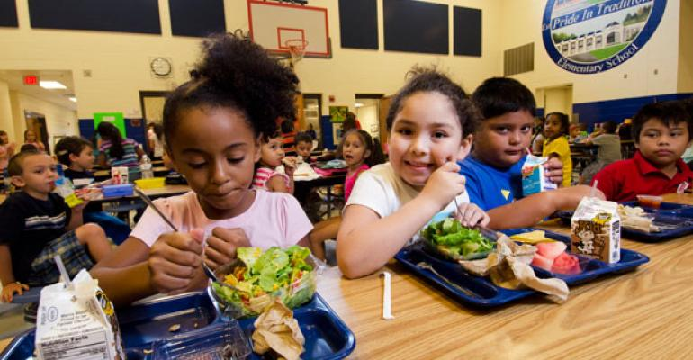 Trump administration rolls back Michelle Obama's healthy school lunch program