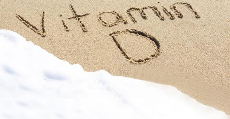 Vitamin D written in sand