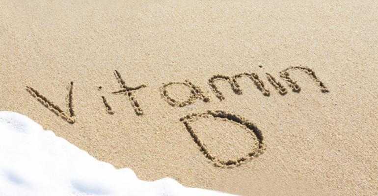 Vitamin D written in sand on beach