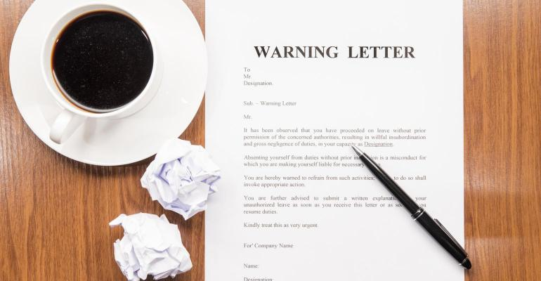 Warning letter and cup of coffee