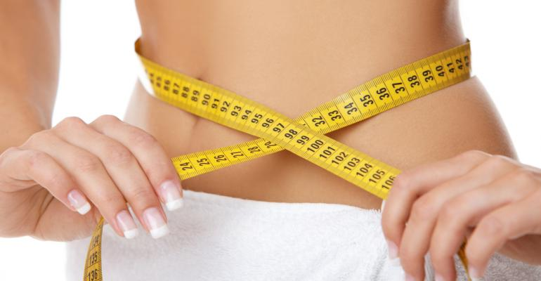 Woman's midriff with measuring tape
