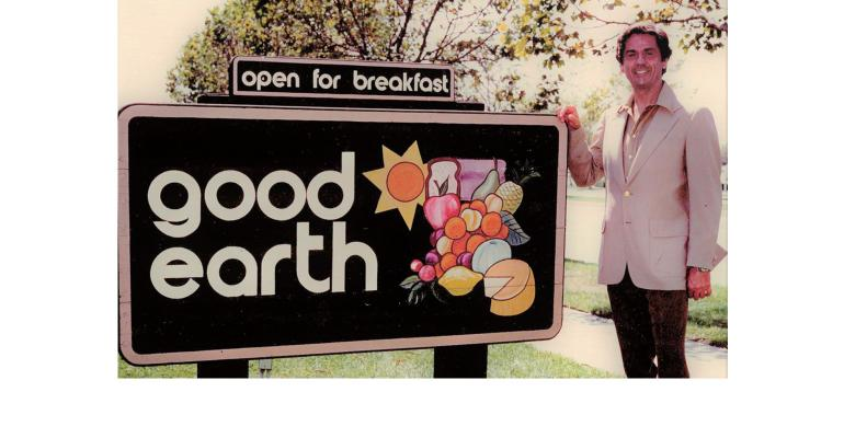 William Galt with Good Earth restaurant sign