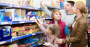 Family choosing products at grocery store