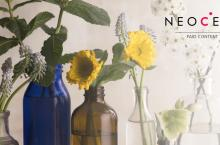 Bottles with flowers and NeoCell logo