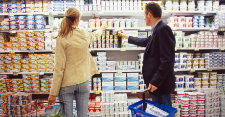 Man and Woman Looking at Yogurt