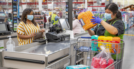 Walmart shopper at checkout during COVID-19