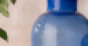 Close-up of blue bottles with Sabinsa logo