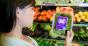 woman looking at organic label