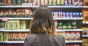 woman grocery shopping at shelf