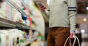 millennial man grocery shopping with cellphone