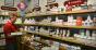 stocking vitamins at health food store